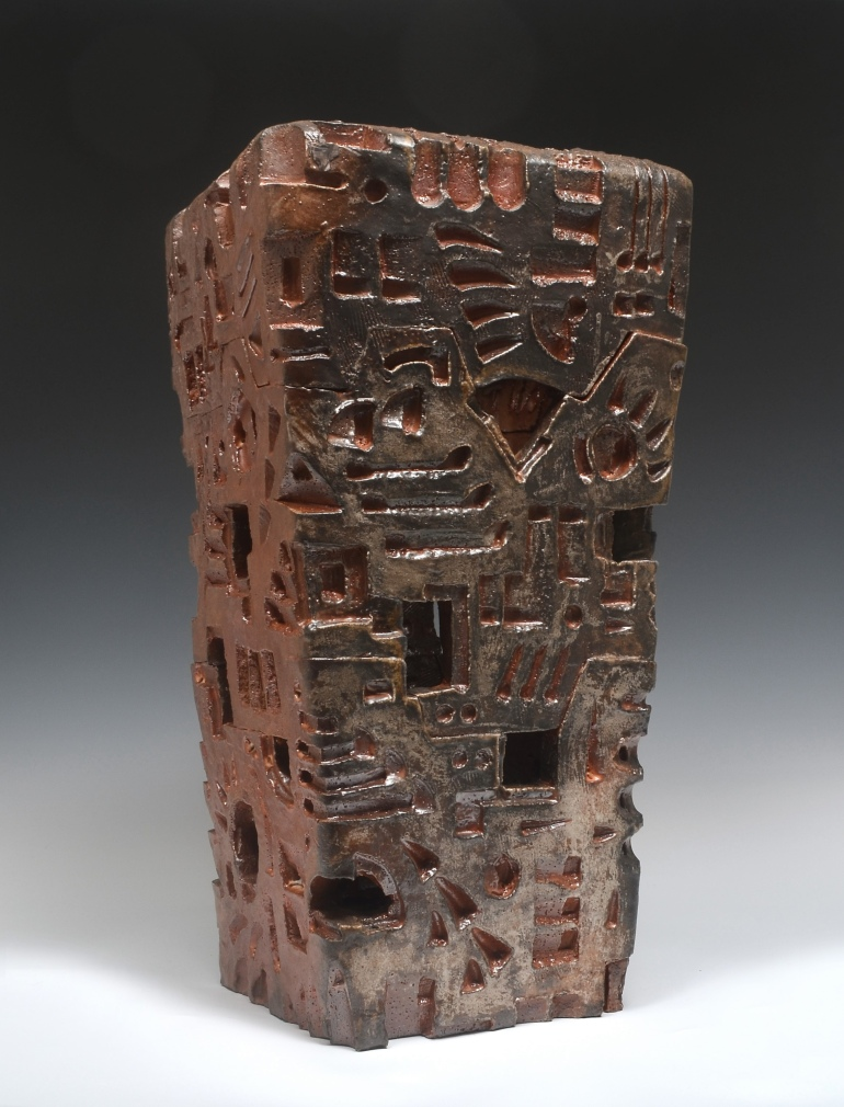 Sculpture with brown red oxide glazing