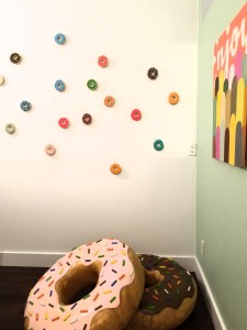 Installation with carved wood donut sculptures by Jon Reichert.